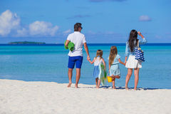 Young family of four on beach vacation Stock Photo