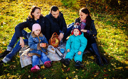 Happy young family of four having picnic at meadow at summer day royalty free stock photography