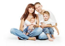 Young family four persons, smiling father mother and two children sons. Over white background royalty free stock photos