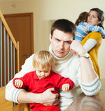 Young family of four after quarrel Stock Photo