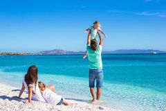 Young family of four during summer beach vacation Stock Photo