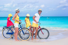 Young family of four with two kids riding bicycles Stock Photography