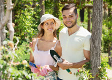 Young family gardening. Young couple gardening together in spring garden stock photos