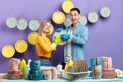 Young family getting pleasure from household chores stock photo