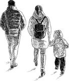 A young family goes on a walk Stock Images