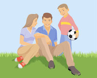 Young family on the grass Royalty Free Stock Image
