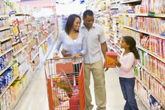 Young family grocery shopping Royalty Free Stock Photography
