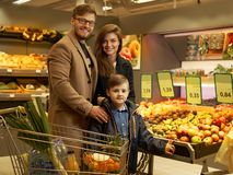 Young family in grocery store Royalty Free Stock Photography