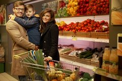 Young family in grocery store Stock Photography