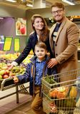 Young family in grocery store Royalty Free Stock Photos