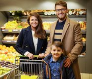 Young family in grocery store Royalty Free Stock Images