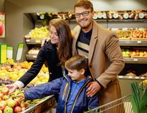 Young family in grocery store Stock Image