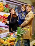 Young family in grocery store Royalty Free Stock Image