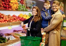 Young family in grocery store Stock Photo
