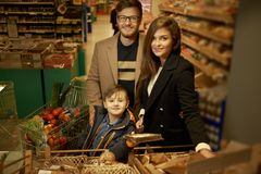 Young family in a grocery store Stock Images