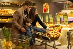 Young family in a grocery store Stock Image