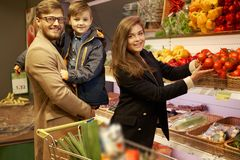 Young family in a grocery store Royalty Free Stock Image