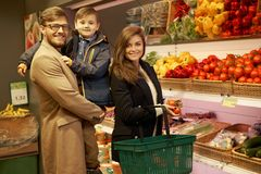 Young family in a grocery store Royalty Free Stock Images