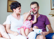 Young family. Happy young family with little child at home Stock Images