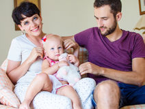Young family. Happy young family with little child at home Royalty Free Stock Photo