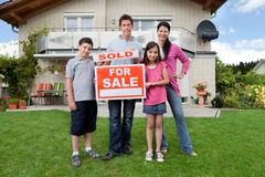 Young family happy to have bought a home stock photos