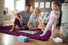 Young family happy together. Young family with cute female child happy together stock photography