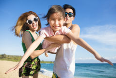 young Family Having Fun at the Beach Stock Image