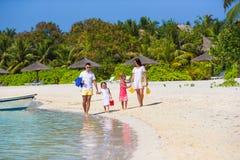 Young family having fun on beach Stock Photos