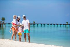 Young family having fun on beach Stock Image