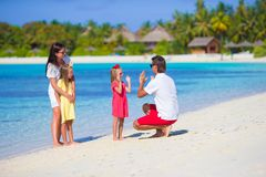 Young family having fun on beach Stock Photography
