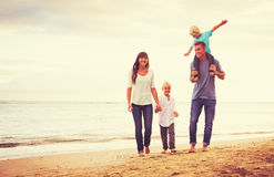 Young Family Having Fun on the Beach Royalty Free Stock Photo