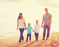 Young Family Having Fun on the Beach Royalty Free Stock Images