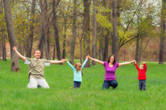 Young family having fun in the forest Stock Image