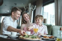 Young family having lunch. In a restaurant Stock Photos