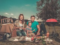 Young family having picnic Stock Photos