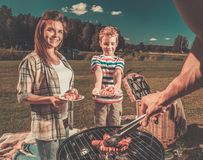 Young family having picnic Royalty Free Stock Photography