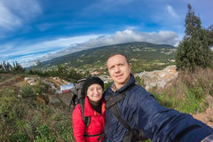 Young family hiking in the mountains. Royalty Free Stock Images