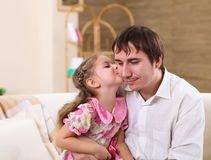 Young family at home with a daughter Stock Photos