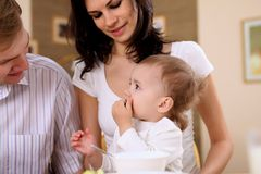 Young family at home having meal Stock Photo