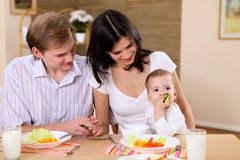 Young family at home having meal Royalty Free Stock Images