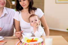 Young family at home having meal Stock Photography