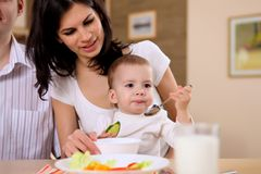 Young family at home having meal Royalty Free Stock Photography
