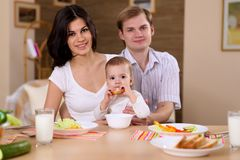 Young family at home having meal Royalty Free Stock Photo