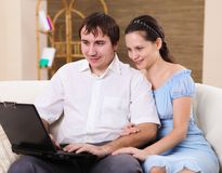Young family at home with a laptop Stock Image