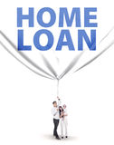 Young family with home loan banner Stock Photo
