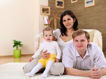 Young family at home playing with a baby Stock Photography