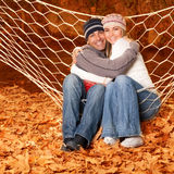Young family hugging in hammock Stock Image