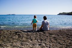 A young family on a journey with a young son Royalty Free Stock Photo