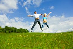 Young family jumping royalty free stock images