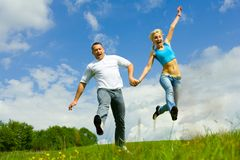 Young family jumping stock images